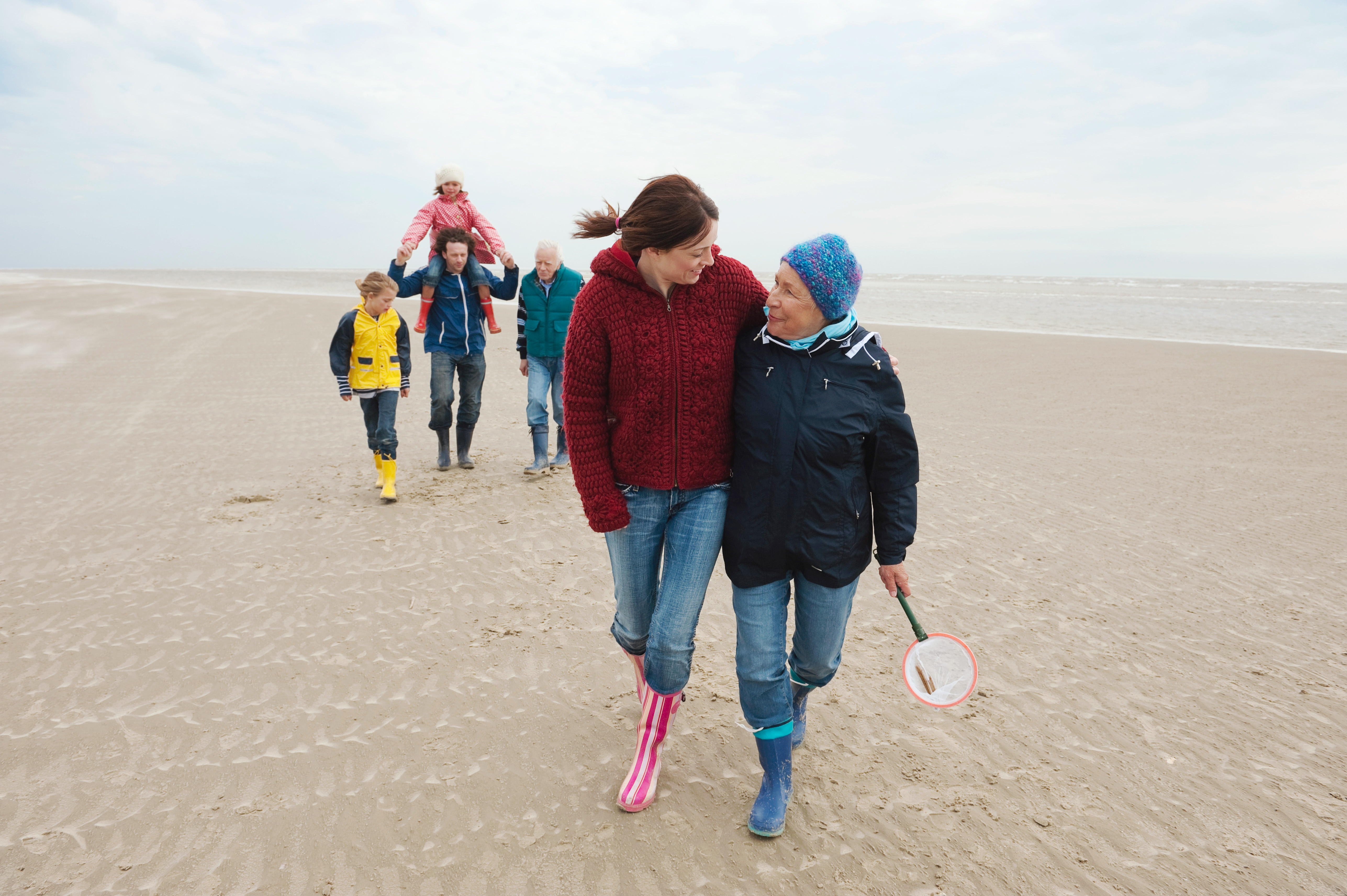 Germany, St. Peter-Ording, North Sea, Family  walking on beach